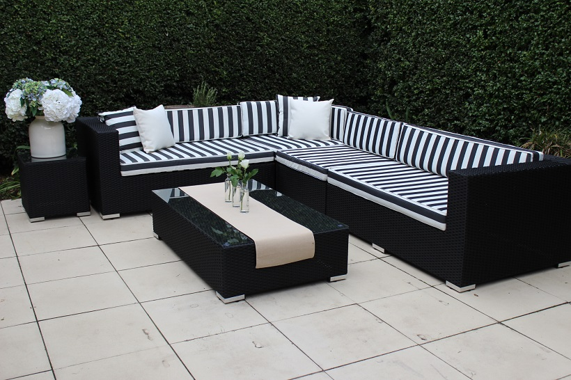 Gartemoebe Modular Outdoor Wicker Furniture -L Shaped Black wicker with black and white striped cushions and matching coffee table