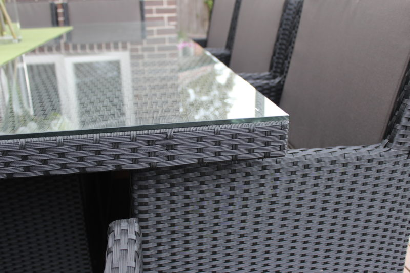 Royale 10 Seater Outdoor Wicker Dining Setting close up on wicker and glass topped table