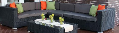 My Wicker charcoal wicker outdoor patio setting with dark grey cushions and accent Green and orange pillows