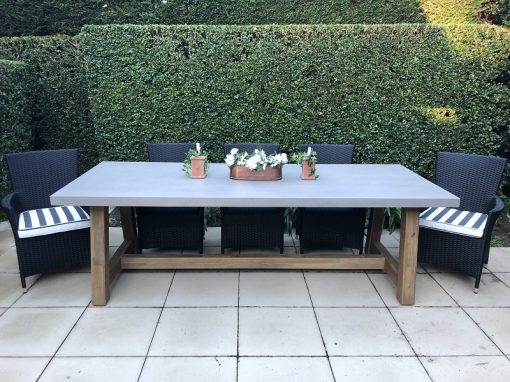 Veltis 8 seater outdoor dining set showing 4 black wicker chairs with striped fabric cushions and grey topped, wooden base rectangular table