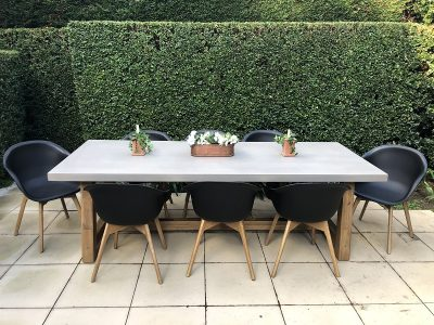 8 Seater industrial look outdoor dining setting with cement top, wooden base rectangular table & 8 hard black chairs
