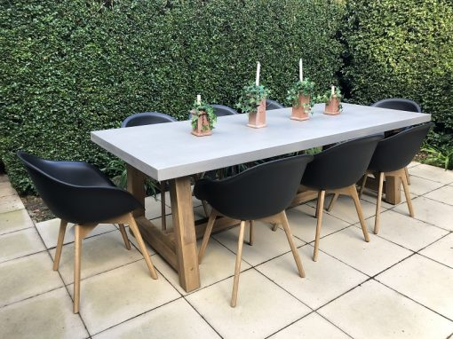 Veltis Dining setting with black bucket chairs